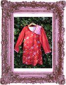 Manoni's tricot jurk medaillon